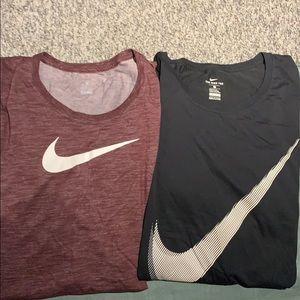 Two plus-size Nike Tees